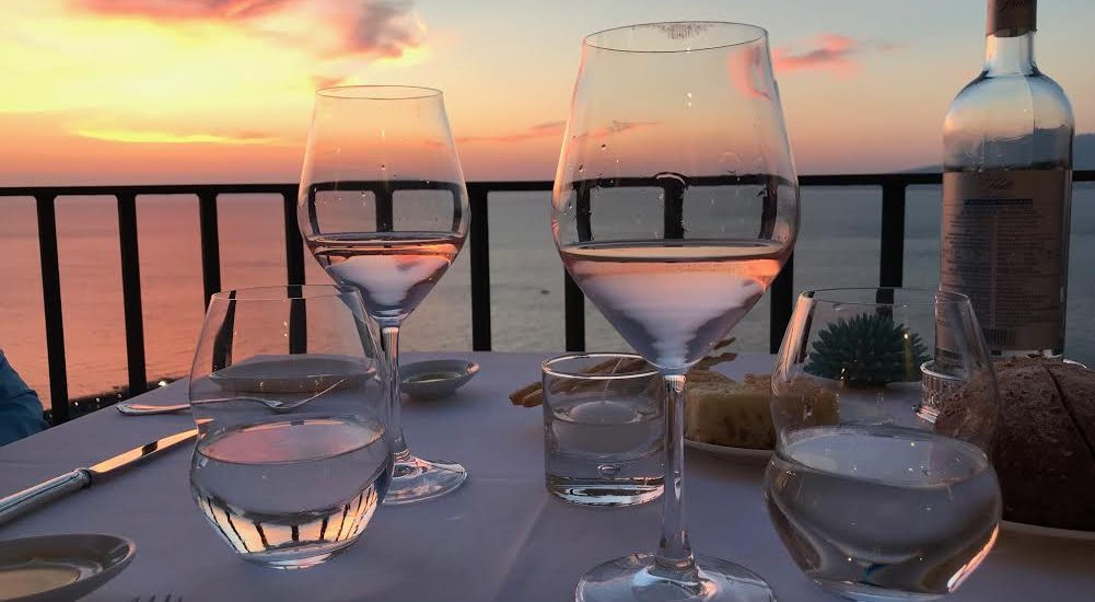 Glasses of Rose in a beautiful setting in Italy on a table