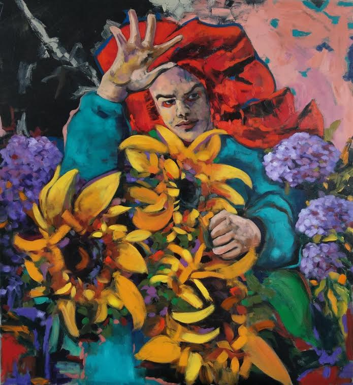A man hidden inside flowers, in a red cloak, seemingly waving away people as not to interrupt him.