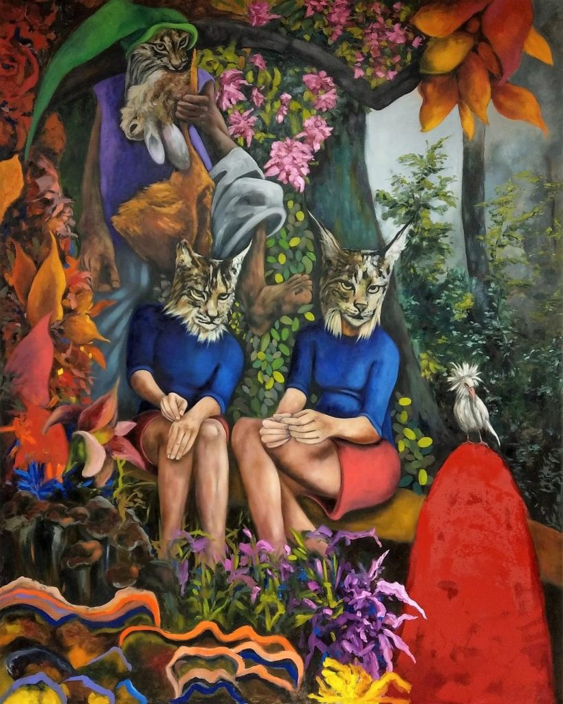 two women sitting on a bench with cat faces with cats in trees.