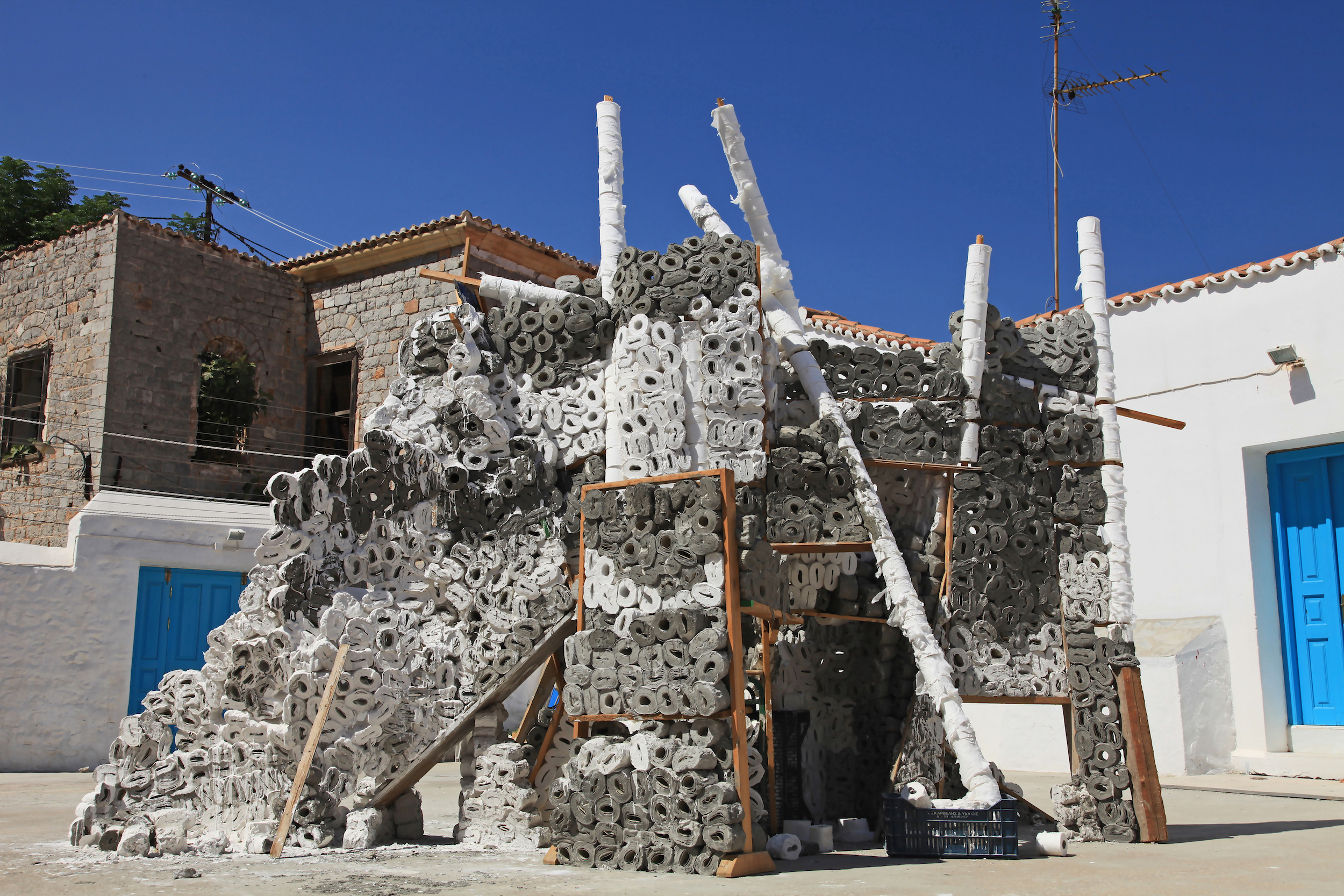 """""""A.M.W.E.""""2010, 4500 toilet rolls, cement, plaster, wood Courtesy the artist and Hydra School Projects"""