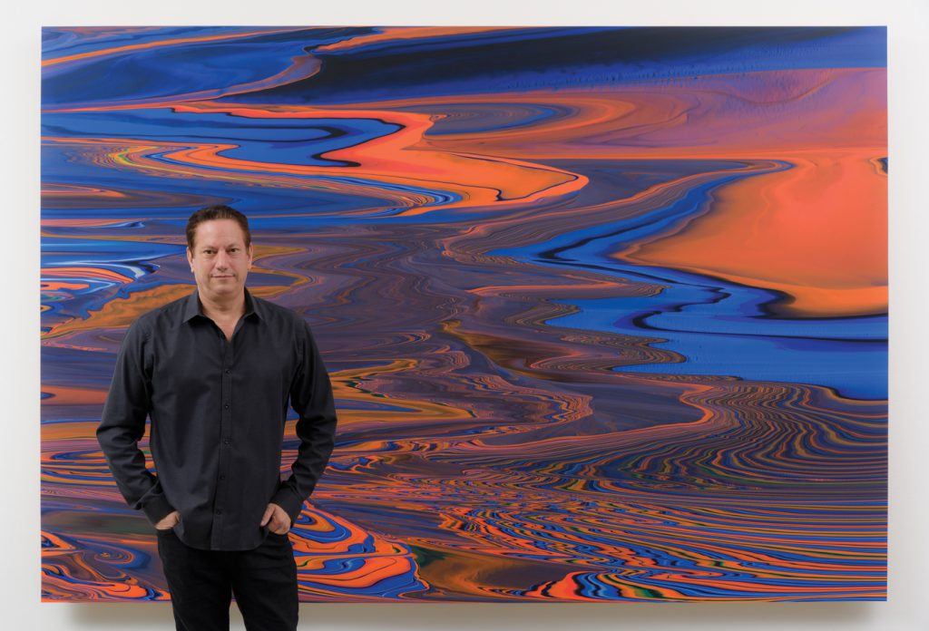 Andy with one of his Geomorph paintings. 2017
